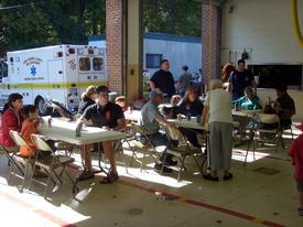 Guests enjoying hot dogs, snacks and drinks at the 2010 Open House
