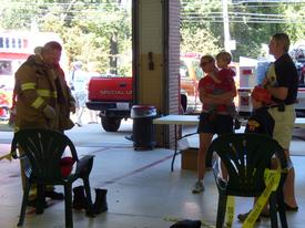 Member Joe Larsen, Sr. demonstrating fire gear at the 2010 Open House